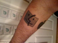 Black funny square smiling fore arm tattoo design